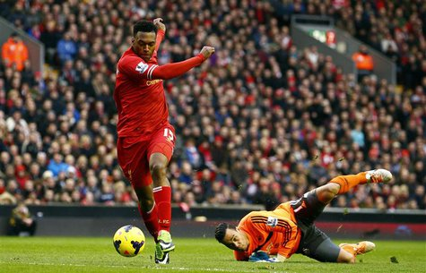 Liverpool's Daniel Sturridge (L) scores past Swansea's Michel Vorm during their English Premier League soccer match at Anfield in Liverpool,