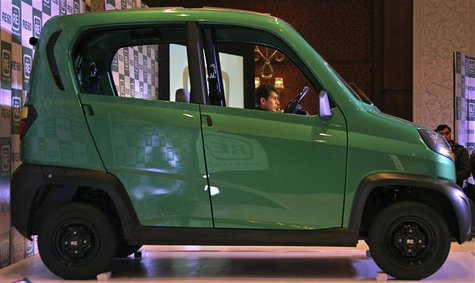 Bajaj's Managing Director Rajiv Bajaj is seen through the windows of the newly launched four-wheeled RE60 in New Delhi in this January 3, 20