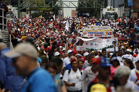 Elderly protesters take part in a march for peace in downtown Caracas February 23, 2014. REUTERS/Tomas Bravo
