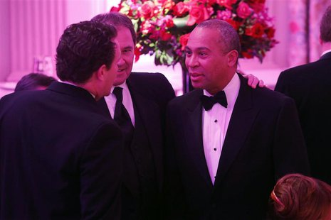 Massachusetts Governor Deval Patrick (D-MA) (R) greets fellow guests before the 2014 Governors' Dinner in the State Dining Room of the White