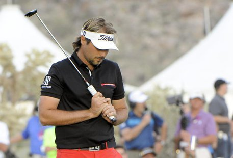 Feb 23, 2014; Marana, AZ, USA; Victor Dubuisson reacts after his putt on the 21st hole after winning the final round of the World Golf Champ