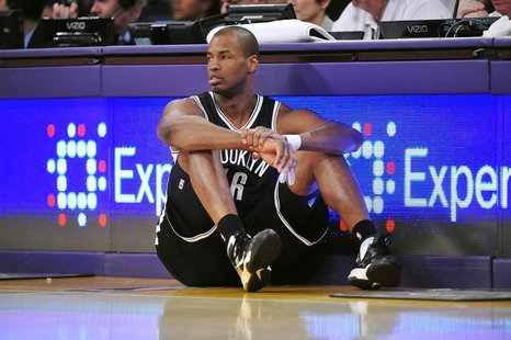 February 23, 2014; Los Angeles, CA, USA; Brooklyn Nets center Jason Collins (46) waits to enter the game against the Los Angeles Lakers duri