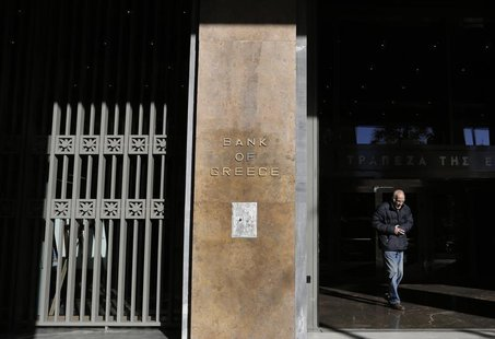 A man leaves the Bank of Greece headquarters in central Athens November 27, 2013. REUTERS/John Kolesidis