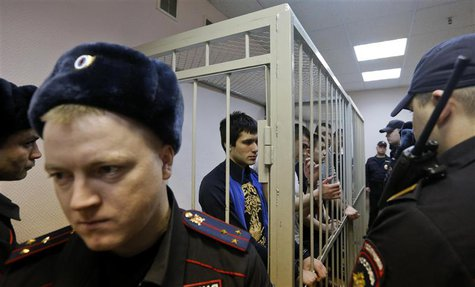 "Defendants in the ""Bolotnaya"" case stand in a holding cell as they wait for their sentencing during a court hearing in Moscow February 24, 2"