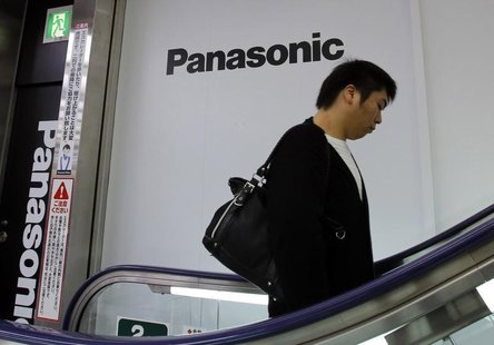 A man walks past Panasonic Corp's logos at an electronics store in Tokyo October 31, 2013. REUTERS/Toru Hanai