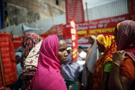 Garment workers who survived the Rana Plaza building collapse take part in a protest to demand for compensation, on the six month anniversar