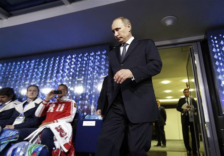 Russian President Vladimir Putin walks out from the presidential lounge to take his seat as he is introduced during the closing ceremony for
