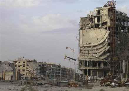Damaged buildings are pictured in the besieged area of Homs February 22, 2014. REUTERS/Thaer Al Khalidiya