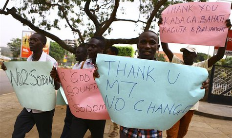 Anti-gay supporters celebrate after Uganda's President Yoweri Museveni signed a law imposing harsh penalties for homosexuality in Kampala Fe