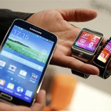 New Samsung Galaxy S5 smartphone (L), Gear 2 smartwatch (C) and Gear Fit fitness band are displayed at the Mobile World Congress in Barcelon