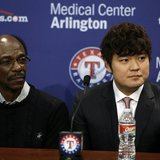 Dec 27, 2013; Arlington, TX, USA; Texas Rangers manager Ron Washington (left) and outfielder Shin-Soo Choo (right) talk to the media during