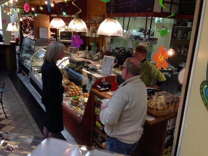 Democratic gubernatorial candidate Mary Burke talks with small business owners in Appleton, Monday, Feb. 24, 2014. (Photo from: FOX 11).
