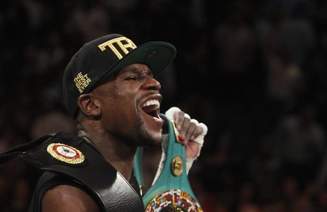 Floyd Mayweather Jr. of the U.S. celebrates his victory over WBC/WBA 154-pound champion Canelo Alvarez at the MGM Grand Garden Arena in Las