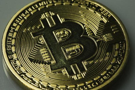 A mock Bitcoin is displayed on a table in an illustration picture taken in Berlin January 7, 2014.REUTERS/Pawel Kopczynski