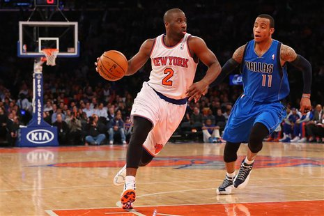 Feb 24, 2014; New York, NY, USA; New York Knicks point guard Raymond Felton (2) dribbles the ball in front of Dallas Mavericks shooting guar