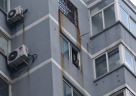 Guzailai Nu'er, the wife of Ilham Tohti, speaks as she has an interview with Reuters by a phone from window of her house in Beijing, January