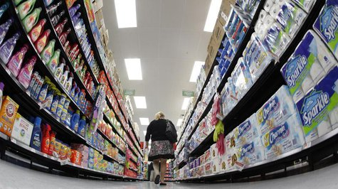 A shopper walks down an aisle in a newly opened Walmart Neighborhood Market in Chicago in this September 21, 2011 file photo. REUTERS/Jim Yo