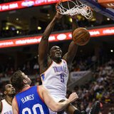 Oklahoma City Thunder center Kendrick Perkins (5) dunks during the first quarter against the Philadelphia 76ers at the Wells Fargo Center. M