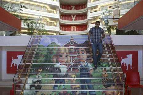 Player avatars from Zynga's FarmVille 2 are seen on a stairway at the entrance to Zynga headquarters in San Francisco, California April 23,