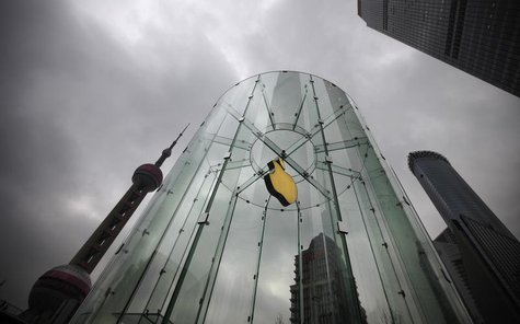 An Apple logo is seen at an Apple store in Pudong, the financial district of Shanghai February 29, 2012. REUTERS/Carlos Barria