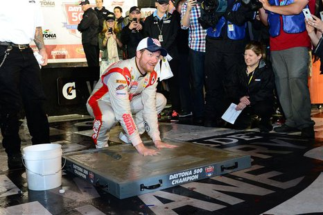 NASCAR Sprint Cup driver Dale Earnhardt Jr (88) inshrines his hands in cement after winning the Daytona 500 at Daytona International Speedwa
