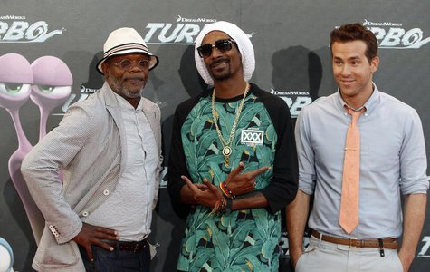 (R-L) Voice cast actors Ryan Reynolds, Snoop Dogg, also known as Snoop Lion, and Samuel L. Jackson pose during the world premiere photocall
