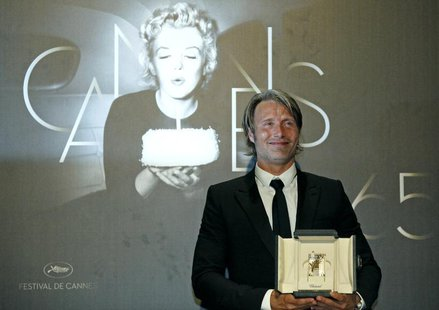 "Best Actor award winner Mads Mikkelsen for the film ""Jagten"" (The Hunt) poses during a photocall after the awards ceremony of the 65th Canne"