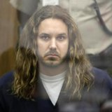 Tim Lambesis, lead singer for the heavy metal band As I Lay Dying, looks on during his arraignment in San Diego North County court in Vista,