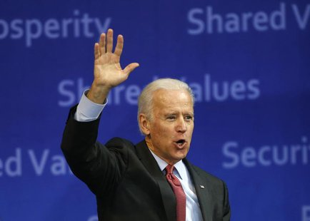 U.S. Vice President Joe Biden waves to the crowd as he leaves after delivering his speech at Yonsei University in Seoul December 6, 2013. RE
