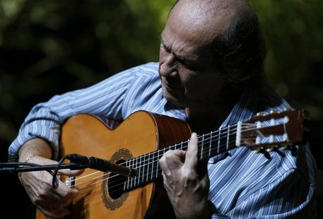 Spanish flamenco guitarist Paco de Lucia plays a guitar during a rehearsal of closing concert of the Biennial of Flamenco in the Andalusian