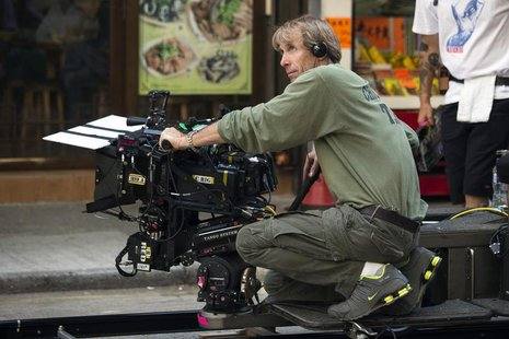 "U.S director and producer Michael Bay holds a camera during the filming of a scene for the movie ""Transformers: Age of Extinction"" in Hong K"