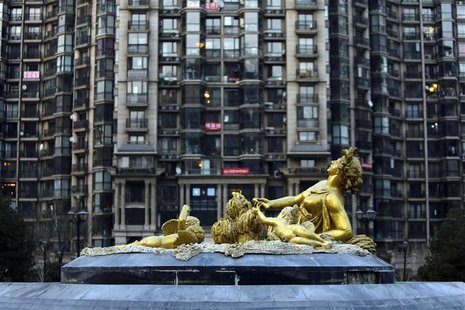 A sculpture is seen in front of an apartment block in Beijing January 16, 2014. REUTERS/Jason Lee
