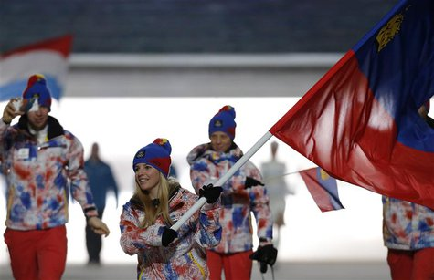 Liechtenstein's flag-bearer Tina Weirather leads her country's contingent during the athletes' parade at the opening ceremony of the 2014 So