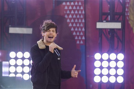 Singer Louis Tomlinson of the band One Direction performs on ABC's Good Morning America inside Central Park in New York, November 26, 2013.