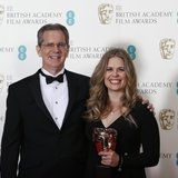 "Chris Buck and Jennifer Lee celebrate after winning the Animated Film category for ""Frozen"" at the British Academy of Film and Arts (BAFTA)"