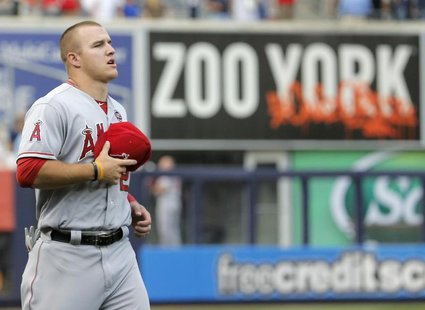 Los Angeles Angels center fielder Mike Trout runs past an outfield sign before playing the New York Yankees in their MLB American League gam