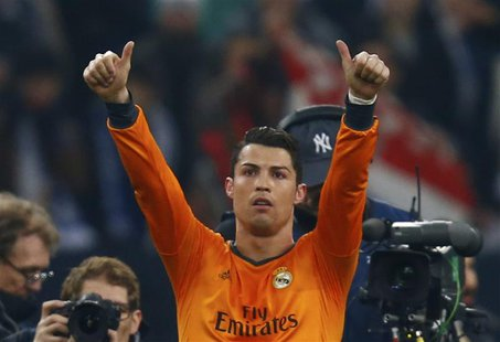 Real Madrid's Cristiano Ronaldo reacts after their Champions League soccer match against Schalke 04 in Gelsenkirchen February 26, 2014. REUT