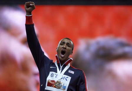Gold medallist Ashton Eaton of the U.S. celebrates during the award ceremony for the men's decathlon during the IAAF World Athletics Champio