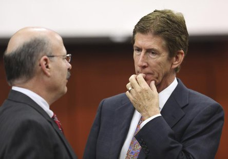 Defense counsel Mark O'Mara (R), talks to prosecutor Bernie de la Rionda during George Zimmerman's trial in Seminole circuit court in Sanfor
