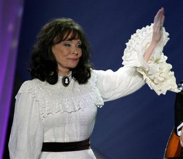 "Loretta Lynn waves after performing the song ""Miss being Mrs."" at the 39th annual Academy of Country Music Awards at the Mandalay Bay Events"