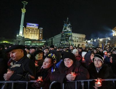 People attend a rally in Independence Square in Kiev, February 26, 2014. REUTERS/Konstantin Chernichkin
