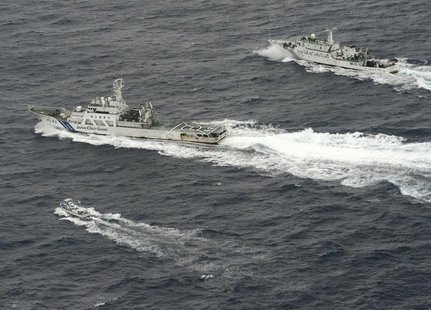 An aerial photo shows Chinese marine surveillance ship Haijian No. 66 (top) trying to approach a Japanese fishing boat (bottom) as Japan Coa