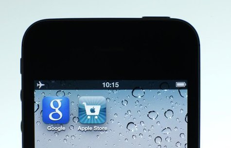 Google and Apple applications are seen on the display of IPhone in this photo illustration taken in Berlin, August 31, 2012. REUTERS/Pawel K