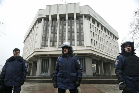 Interior Ministry members stand guard near the Crimean parliament building in Simferopol February 27, 2014. REUTERS/David Mdzinarishvili