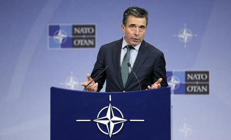 NATO Secretary-General Anders Fogh Rasmussen addresses a news conference during a NATO defence ministers meeting at the Alliance headquarter