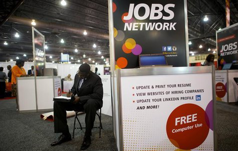 A job-seeker completes an application at a career fair held by civil rights organization National Urban League as part of its annual confere