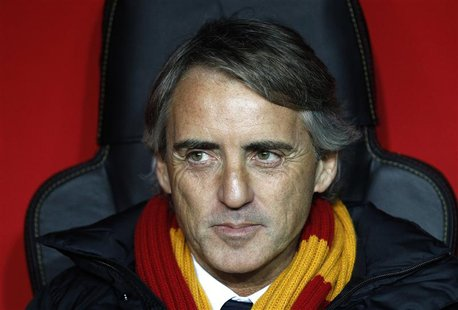 Galatasaray's coach Roberto Mancini reacts before the start of his team's Champions League soccer match against Chelsea at Turk Telekom Aren
