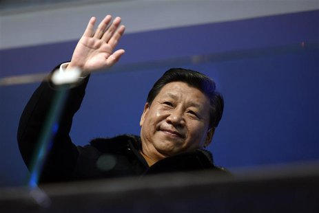 China's President Xi Jinping waves from the presidential tribune at the opening ceremony of the 2014 Winter Olympics in Sochi, February 7, 2