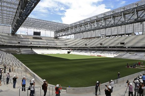 Journalists visit inside the Arena da Baixada soccer stadium as it is being built to host matches of the 2014 World Cup in Curitiba, Februar
