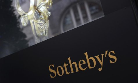A video display panel is seen outside Sotheby's in London October 4, 2013. REUTERS/Suzanne Plunkett
